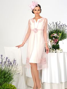 This beautiful Dress Code by Veromia dress is platinum white, matched with a stunning light pink sheer gown with flower embellishment. Product code DC004.  View more Mother of the Bride / Groom dresses from our Dress Code by Veromia collection at: http://www.baroqueboutique.co.uk/mother-of-the-bride-south-wales/ Photographs courtesy of: http://veromia.co.uk/Mother-of-the-Bride.html