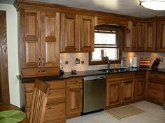 Kitchen remodel in Custer, Wisconsin. Designed by Janet Plier with Welling Woodworks in Stevens Point, WI. StarMark Cabinetry Melbourne door style in Hickory finished in Toffee.