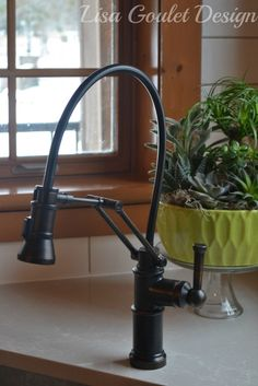 Collection: Artesso • Finish: Venetian Bronze • Product: Single-Handle Articulating Kitchen Faucet • Space designed by: Lisa Dickner-Goulet