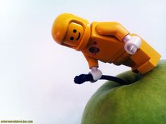 Yellow LEGO astronaut and an apple!
