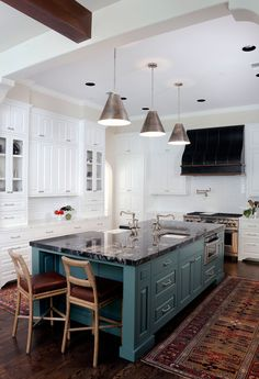 Spectacular white marble countertops (Paonazzo, Walker Zanger) along with stark white cabinetry (Benjamin Moore, Snow White) provides a perfect contrast to the black granite (Titanium) on the island. A shot of color (Benjamin Moore, Jack Pine) on the island, the range hood (custom designed by Linda Eyles and fabricated by Lone Star Hood Company), Circa Lighting Goodman Hanging Lamps over island and a rich wood floor make this kitchen a real stand out. McGuire Thomas Pheasant Laced Back ...