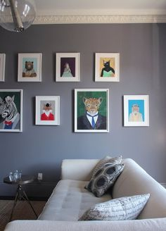 Such a fun idea for a wall.  These portraits have a sense of humor and look great.