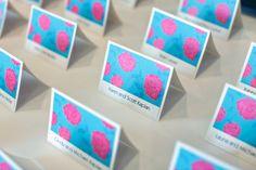 Pretty pink  blue flower escort cards for a Bat Mitzvah {Photo by Karen Ard Photography}