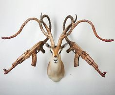 Normally, I would admire these pieces of armed taxidermy as simple, wondrous fusions of guns and dead things, created by a mind that exists on a much higher plane of superbly twisted ideas than mine, and leave it at that. I am not sure why, But I want this.