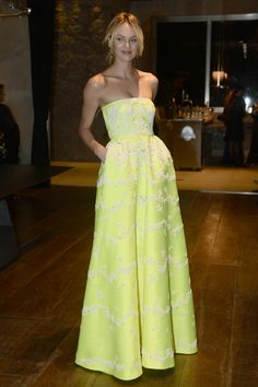 Candice Swanepoel caught our eye in this vibrant yellow embroidered Valentino gown