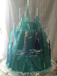 """Frozen"" Elsa's ice castle birthday cake. 3 tear cake covered in glass candy."