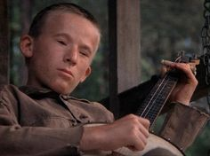 An inbred albino boy, known for playing the banjo. The boy is inbred and extremely quiet, as he doesn't say a word at all while encountering the four men who came to canoe. The banjo kid is extremely adept with the banjo, and plays a song with Drew for his own amusement. The kid plays with Drew for about two minutes before Drew loses track and the kid finishes the song. The boy foreshadowed the dangers of what was to come.