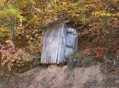 An outhouse sitting ever so precariously on the edge of the road in the back woods of Gatlinburg, TN 2008 Lisa Smith Glenn, All Rights Reserved