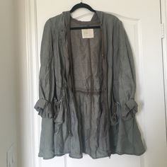 Green Quarter Sleeve Coat from Free People It's a size large so it's really roomy. It was only worn a handful of times, but it's still in great condition. The only reason I'm giving it up is because I ended up getting a similar type of coat that fit my figure better. Price is negotiable. Free People Jackets & Coats