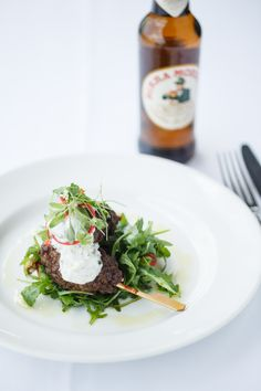 Lamb Kofta served with Tzatziki & Rocket Salad, one of the delicious dishes on our Dining Room's Express Menu.
