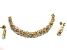 This is designer american diamond  necklace set with earrings . the base of this necklace is made of brass & the upper design is covered with American diamond. Order Now -  just click.http://www.rajranibangles.com/product-A.D.-Jewellery-1066.aspx