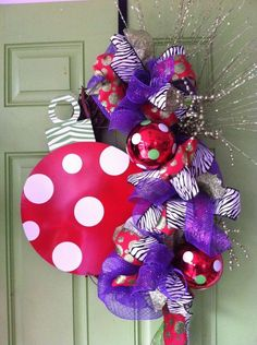 If you're a little more on the traditional side, this wreath is for you! I love the red and purple combination. Ornament can be personalized. By Four Silly Monkeys!