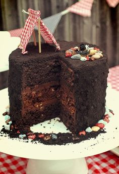 Dirt cake w/chocolate rocks and gummy worms.  Could do cupcakes also. Oh my goodness B would absolutely flip over this.