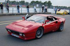 Red Ferrari 288 GTO and yellow Venturi 400 GT