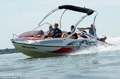 Wave Boat 444 converts a jet-ski into a five-seater boat Wave Boat, Sun Roof, Ski Boats, Jet Ski, Skiing, Waves, Mail Online, Daily Mail, Knots