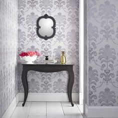 For a damask wallpaper with a difference it has to be La Palma, inspired by a tropical palm tree it's a classic with a twist. A glittering background and a gilded effect to the design in a range of bang on trend catwalk colours this design is perfect to give your walls some sparkle. This sophisticated lilac wallpaper with silver glitter highlights is subtle enough to be used on all four walls in any room in your home. This design from the glitterati collection from Julien Macdonald has been…