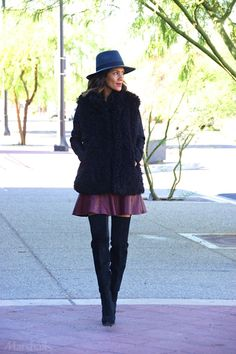 Uptown chic. Over-the-knee boots make a statement from the ground up. We love the look with this wine-toned skater skirt. Get cozy with your layers — style a black cable knit sweater under a super-soft fuzzy vest. See more outfit inspiration when you click through!
