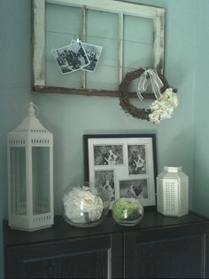 Shabby Chic Entry Way - I like the old window frame used for photos with clips and wire.
