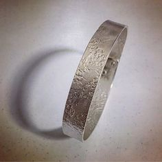 #thejourneycontinues working to incorporate the lace texture on the surface of my work in sterling silver using #coldconnection to form the #bangle #herbertandwilks #jewellerydesign #textured #contemporaryjewellery #embellishment #simpledesign