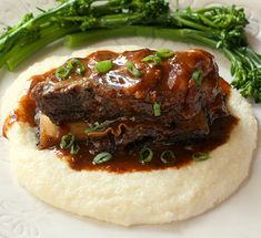 Braised Beef Short Ribs with Cheesy Horseradish Grits and Sweet and Sour Porter Sauce. All I want is the cheesy horseradish grits. Meat Recipes, Slow Cooker Recipes, Dinner Recipes, Cooking Recipes, Cocktail Recipes, Dinner Ideas, Jewish Recipes, What's Cooking, Crockpot Recipes