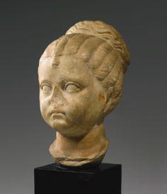 A Roman Marble Portrait Head of a Girl, Flavian or Trajanic, circa A.D. 90-110