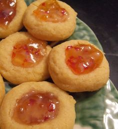 A savory take on the classic thumbprint cookies.  Cheese straw dough shaped into thumbprints and filled with pepper jelly.