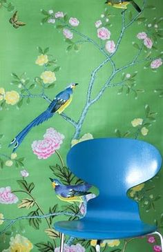 Green chinoiserie wallpaper, paired with an Arne Jacobson style chair, such different eras, to say the least... unexpected, but fun! Pretty colors!