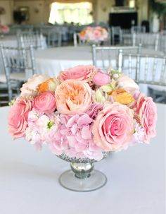 sweet pea floral design coral peach pink garden rose juliet ranunculus andromeda astilbe roses stock in mercury glass compote for barton hills country club ann arbor wedding reception guest table centerpieces