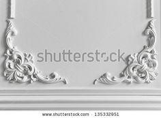 Beautiful ornate white decorative plaster moldings in studio - stock photo