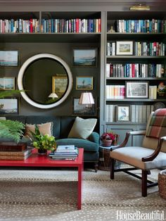 "In the library of Connie Newberry's Dutchess County, New York, house, a sofa covered in Holland & Sherry moleskin blends into the walls. A coffee table from Gerald Bland ""adds the pop of red every room needs,"" Newberry says. Antelope carpet by Stark."