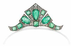 An art deco emerald and diamond tiara/brooch/double-clip combination, circa 1935