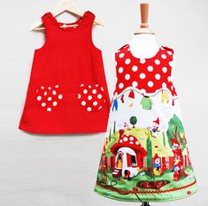 A gnome print funky little girl's reversible pinafore. A fun and very useful little dress sure to be a favourite this spring. British made.Main print features cheeky busy little gnomes about their daily work.( print runs around the whole hem) Reverse is a simple , stunning red baby cord with a little polkadot pockets. Simple retro A line shape. Easy reversible button shoulder fastening. Wear layered with stripey tights and bright cardis. Quality Handmade dress by Wild things Funky little…