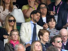 30 June Olivia Palermo, Johannes Heubl and Daisy Lowe take in the action.   - HarpersBAZAAR.co.uk