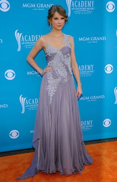 Taylor Swift Evening Dress - Taylor looked radiant in a lavender chiffon, embroidered gown with a sheer neckline.  The country princess was definitely one of the best dressed of the night.  Brand:  Marchesa