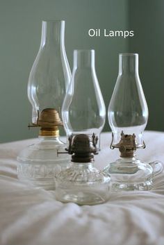 Oil lamps mixed in with clear glass bottles, milk glass and mason jars…color i… - Lamp Ideas