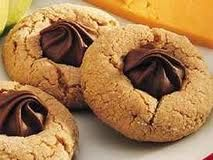Peanut Butter Blossoms - they taste so much better with the chocolate stars instead of chocolate kisses.