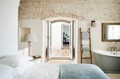 Masseria Petrarolo is a Wedding Venue in Puglia, Italy. See photos and contact Masseria Petrarolo for a tour. Rustic Italian Decor, Italian Farmhouse, Italian Home, Rustic Style, Bedroom With Bath, Baths In Bedrooms, Luxury Accommodation, Country Style Homes, Awesome Bedrooms