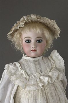 20' A. TUILLIER BEBE MARKED 'A 7 T'. BISQUE SOCKET HEAD ON BISQUE SHOULDERPLATE, MOHAIR WIG ON CORK PATE, BEAUTIFUL PAPERWEIGHT EYES...