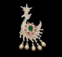 CHRISTIAN DIOR signed rhinestone and faux pearl figural peacock brooch