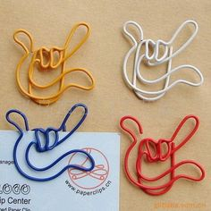 "Go to this website: http://www.paperclips.cn/products.asp?page=5&keyword=&Classid=17...and if needed, search under ""fancy shaped paperclips"". Don't know cost."