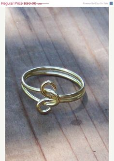 This simple little infinity love knot ring is done in solid bright yellow brass (looks like gold but does not tarnish). Suitable for women, men, unisex.    Ring Size 9.5    This is a OOAK ( one of a kind ) and is ready to ship. $20.00