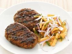"""Beef Kefta with Melon Slaw : """"Kefta"""" is a Middle Eastern meatloaf traditionally served by street vendors. This version, featured in Food Network Magazine, is flavored with cumin, mint and dill — give this new spin a try."""