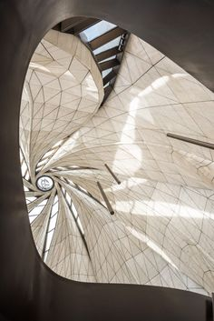Looking up at the beautiful interior of the Bahá'í temple by Hariri Pontarini, Chile, with references to sufi whirling dancers and Japanese bamboo baskets.