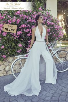 Wedding jumpsuits Wedding trousers and jumpsuits for the fashion-forward bride weddingjumpsuit wedd Wedding Rompers, Ronald Joyce Wedding Dresses, Bridal Gowns, Wedding Gowns, Modest Wedding, Ivory Wedding, Wedding Suits For Bride, Wedding Venues, Wedding Outfits