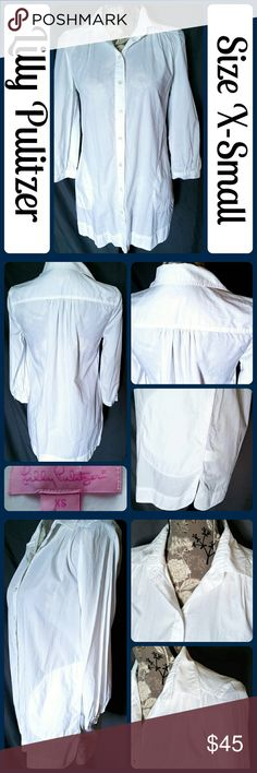 """NWOT Sz XS White Oversized Tunic w/inset pockets So cute and the perfect go to basic! Brand new without tags! 3/4 sleeve tunic top- perfect for leggings and boots or skinny jeans! Wear with a spaghetti tank and you're set. Top is bright white, not faded, 100% Cotton. Across Bust 19"""", Length 30"""" from center back, Sleeve from armpit to end 13"""" No rips, tears, or stains.  ... From a smoke-free, dog friendly home, No trades!! (T161) Lilly Pulitzer Tops Tunics"""