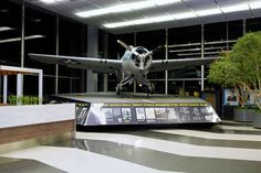 """display at O'Hare Airport. Grumman Wildcat--the type of plane Edward """"Butch"""" O'Hare flew when he wiped out the enemy planes on Feb. 20, 1942."""