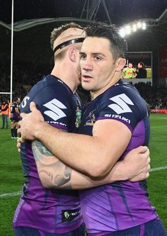 b69e5f63716 Cameron Munster and Cooper Cronk of the Storm hug after winning the NRL  Preliminary Final match