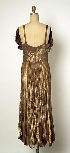 Evening dress (back view) Designer: Gilbert Adrian Date: late 1940s Culture: American Medium: metallic thread, silk Accession Number: 1977.120.5a, b