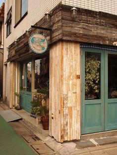 Vapor-tight light fixtures above this rustic storefront