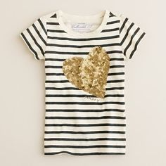 """Look for staple pieces, like this black and white tee, with a little extra """"bling"""" to spice up your wardrobe while still staying on the conservative side."""